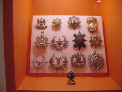 scottish army military cap badges photographs pictures showing images of army hat badges photographed at national museum of scotland part of a collection of scottish photographs